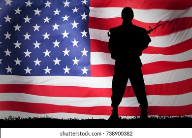 Silhouette Of A Soldier Against Us Flag Background
