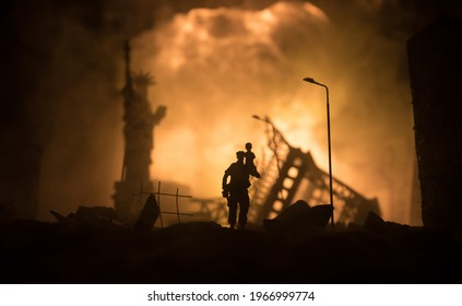Silhouette soldier carrying little boy on his shoulder from fire. Rescue savior concept. Man moving out with little boy from burned out city destroyed in war. Selective focus