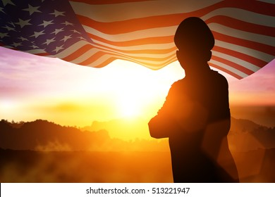 Silhouette of Soldier on the United States flag in sunset  for Veterans Day is an official USA  public holiday background.