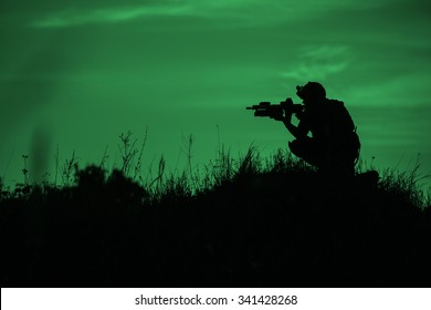 Silhouette of soldier with rifle on a green background