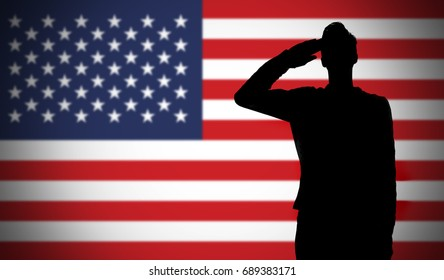 Silhouette of a soldier saluting against the american flag