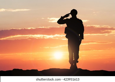 Silhouette Of A Soldier Saluting During Sunset - Shutterstock ID 423951613