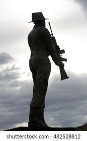 Silhouette of a soldier statue.