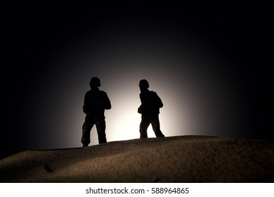 Silhouette of soldiers on a dark background