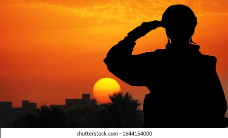 Silhouette Of A Solider Saluting Against the Sunrise in a town on the Mediterranean coast. Concept - armed forces of Turkey, Israel, Egypt