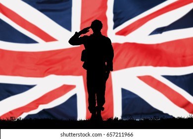 Silhouette Of A Solider Saluting In Front Of The British Flag
