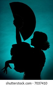 Silhouette of a Spanish flamenco dancer with fan
