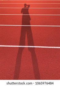 silhouette of sport activity background of ground run track for athletic, red track number running track on athletic stadium for athletic competition, ground for race running.