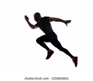 Silhouette of sports man running, isolated on white background