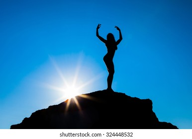 Silhouette of the sports women against the sky