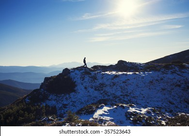 The silhouette of an sportsman which is on the ridge.
