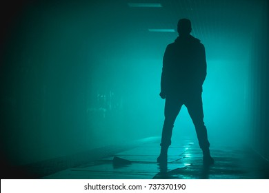Silhouette standing man with in the darkness