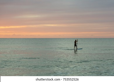 Silhouette of a standup paddler at the north shore of Kauai, Hawaii