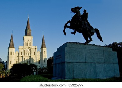 Silhouette of statue in Jackson Square, New Orleans, with St. Louis Cathedral in background