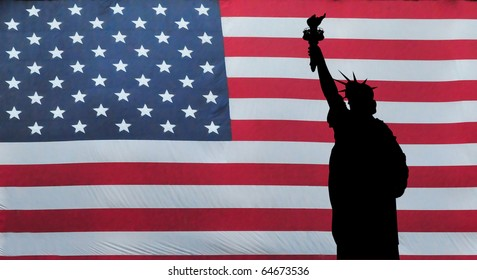 A silhouette of the Statue of Liberty with American Flag in the background