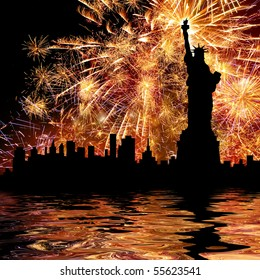 Silhouette statue of liberty on firework background.