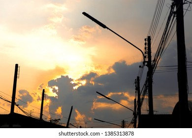 silhouette of street light pole with sunset and beautiful clouds sky exposed in the evening relax time