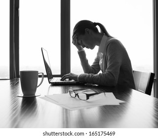 Silhouette of stressed businesswoman