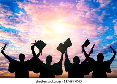 Silhouette of Student Graduation. They are seeing sunset. They are standing and show hand.They are celebration in Graduate , Education,academic,Photo concept Silhouette and Success