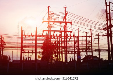 silhouette substation on sunset time, substation on cloud and sky on sunset time background.