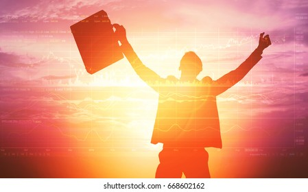 Silhouette of successful businessman trader holding hands and briefcase breathing and standing outdoor with picture chart of stock market investment trading, Forex graph over sunlight sky background.