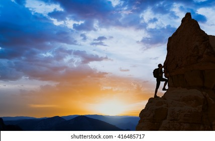 silhouette of successful climbing woman in mountains Concept of motion motivation inspiration at beautiful sunset