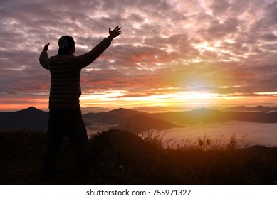 silhouette of successful man on top of mountains both hands up - mission accomplished - destination achieved - travel nature concept - View point 103 Patang, Chiangrai . Thailand