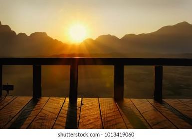Silhouette sun rise on balcony.