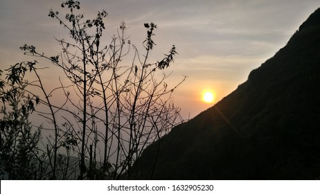silhouette sunrise behind the mountain and beautiful between the tree