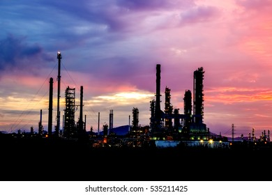 The silhouette sunrise industrial that construct shows only electric light under the colorful sky.