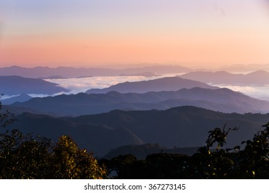 Silhouette of Sunrise and mist with mountain at Doi Mon Jong, Thailand