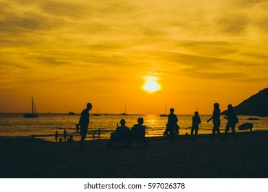 The silhouette of sunset at the beach