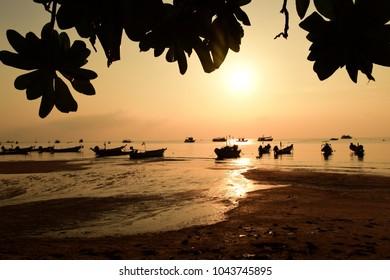 silhouette sunset beach fishing boays