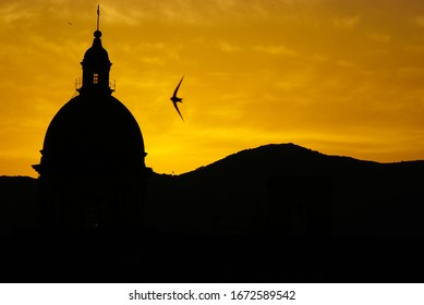 silhouette at sunset of the dome of the Church at the Convent of Carmine Maggiore, in Palermo, Sicily