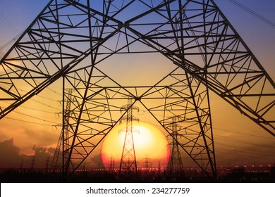 silhouette sunset  of high voltage electrical pole  for electricity generator thermal industry