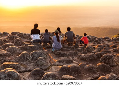 Silhouette of sunset and light flare at the mountain named Lan Hin Poom at Phu Hin Rong Kla National Park, Phitsanulok Province, Thailand