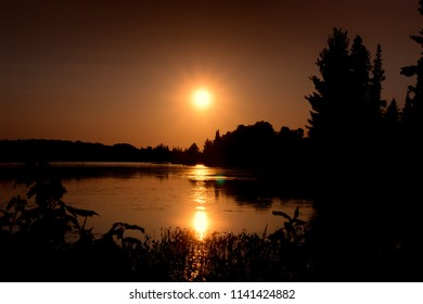 Silhouette Of Sunset On Lake