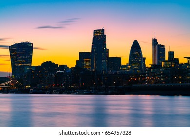 Silhouette sunset view of skyscrapers in financial district of London