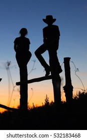 silhouette in the sunset/children on a pasture fence/romantic atmosphere