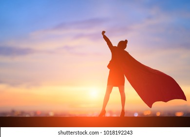 silhouette of super business woman feel excited with sunset