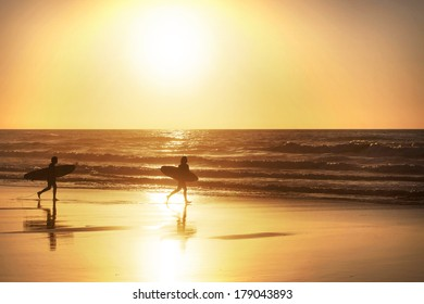 Silhouette of a surfer at sunset, Amado Beach, Portugal