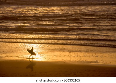 Silhouette of a surfer at sunset on the atlantic ocean, Lacanau France