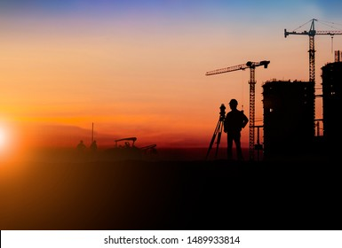 Silhouette of Survey Engineer and construction team working at site over blurred  industry background with Light fair For industrial businesses, global contract work