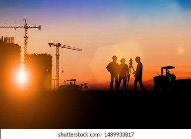 Silhouette of Survey Engineer and construction team working at site over blurred  industry background with Light fair.