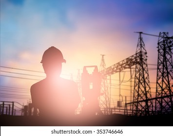 silhouette survey engineer working  in a building site over Blurred construction worker on construction site