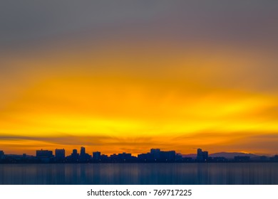 Silhouette tall buildings with beautiful sky and sea at sunset.Koh Larn Pattaya Thailand