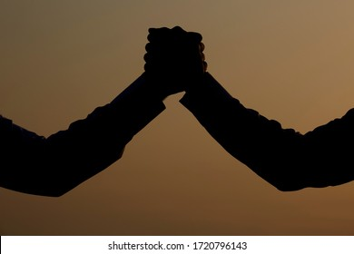 A silhouette of a team activities and dedication.