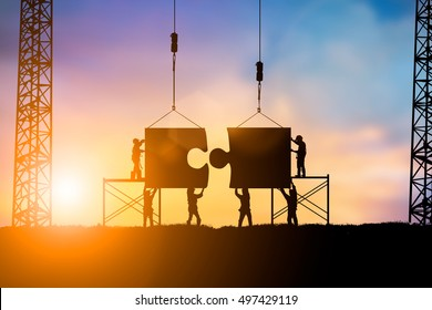 Silhouette Team business engineer work connecting jigsaw puzzle pieces together Teamwork potential and motivate employee to growth over blurred natural background  pastel