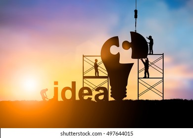 Silhouette Team business engineer work connecting jigsaw puzzle piece together team responsible for the idea of progress and Teamwork potential and motivate employee growth over blurred natural.