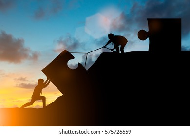 Silhouette team business helps to systematically patience hard work and the pressure to reach the finish line Motivate employee growth concept jigsaw over blurred natural
